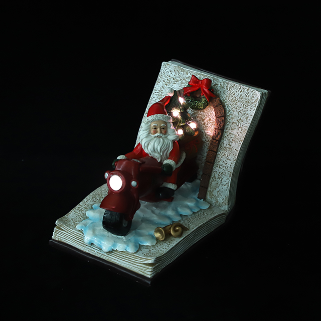 Polyresin Santa Ride Motorcycle with Xmas Tree Ornament with LED in The Book